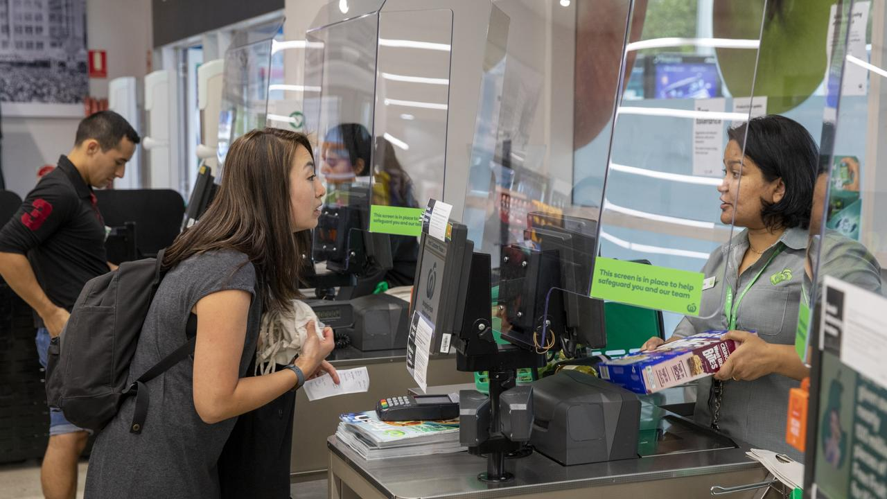 Woolworths has introduced plexiglass screens across its supermarket network to protect workers from being exposed to COVID-19. Picture: Dallas Kilponen.