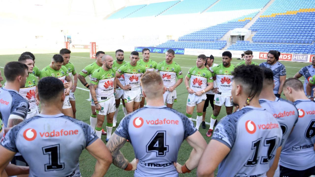 Josh Hodgson and Canberra Raiders players address the NZ Warriors players after the match on the Gold Coast.