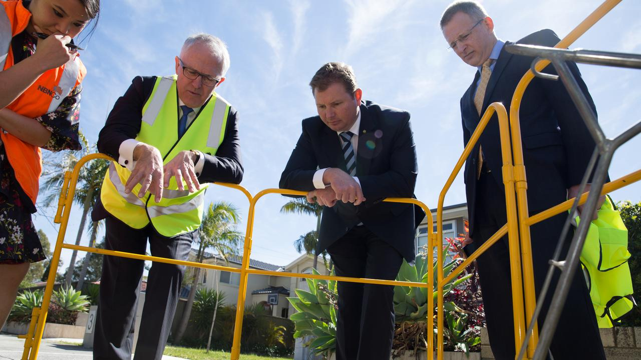 Then Communications Minister Malcolm Turnbull, now retired Liberal MP Craig Laundy and current Communications Minister Paul Fletcher checking progress on the NBN in Homebush.