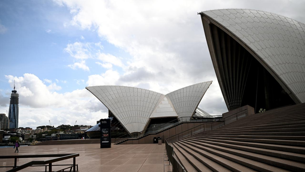 A near-empty Sydney Opera House. Scott Morrison has warned restrictions are likely to last six months. Picture: AAP Image/Joel Carrett