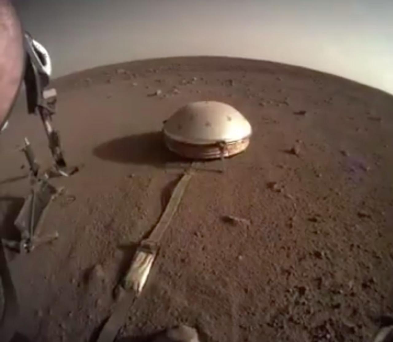 The lander's on-board camera shows the Mars landscape