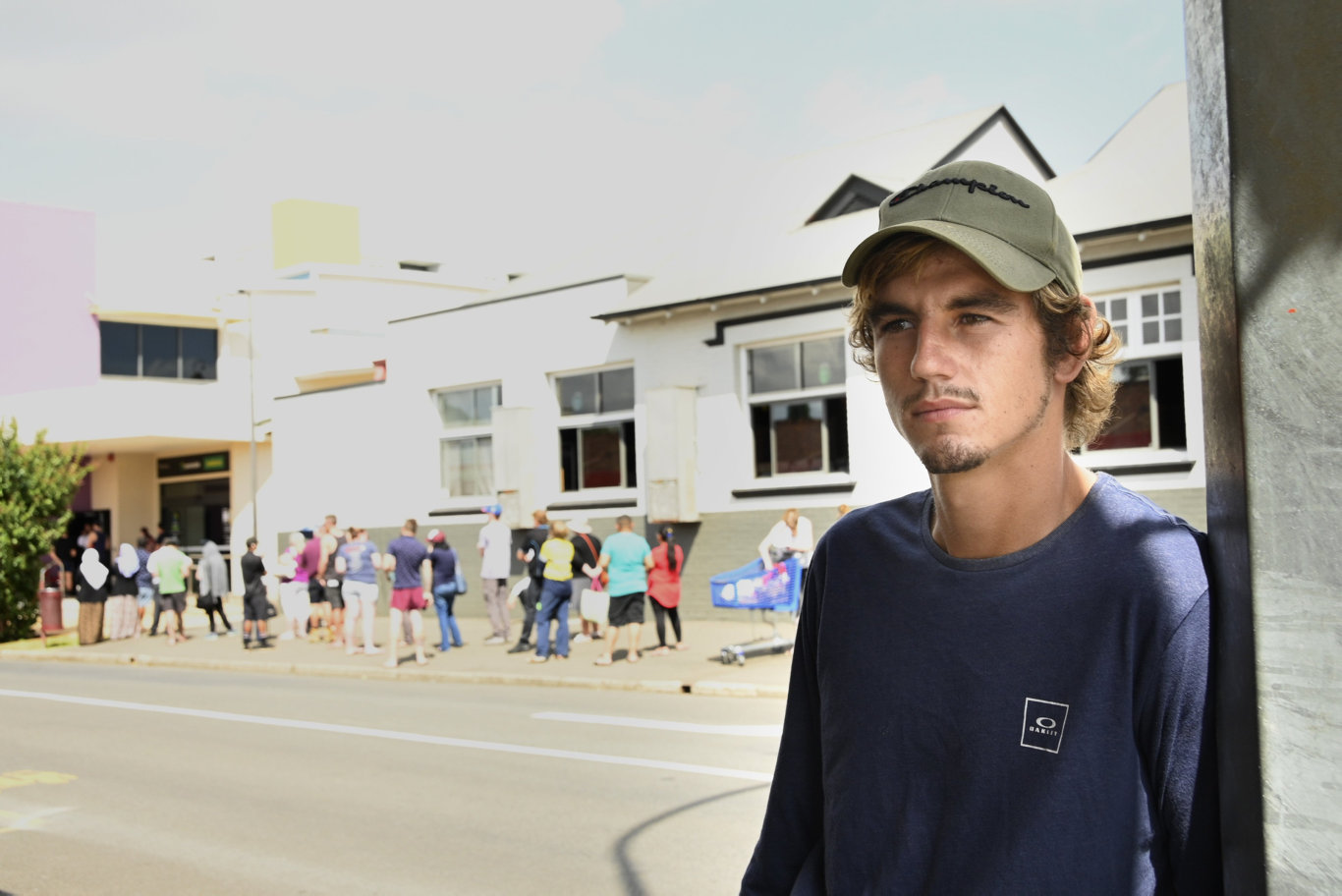 Lachlan Haywood moved to Toowoomba from Bundaberg but the job he was hired for no longer available due to coronavirus. Crowds outside Centrelink office. Picture: Bev Lacey