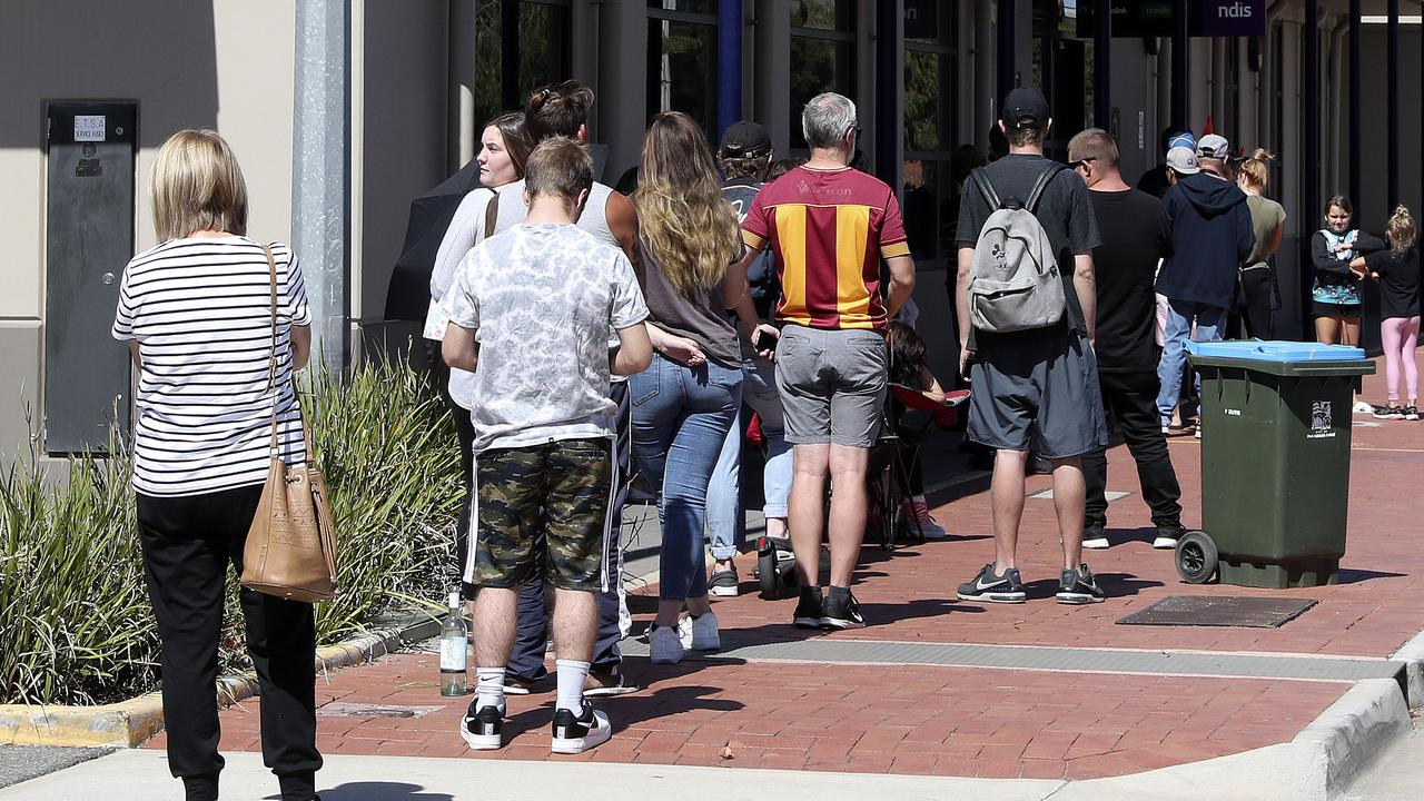 People queue outside Port Adelaide Centrelink waiting to get help. Picture: Sarah Reed