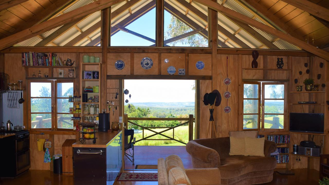 The living room looking out over the towns of Blackbutt and Yarraman at Jan Bagdonas's eco friendly house. (Picture: Tristan Evert)