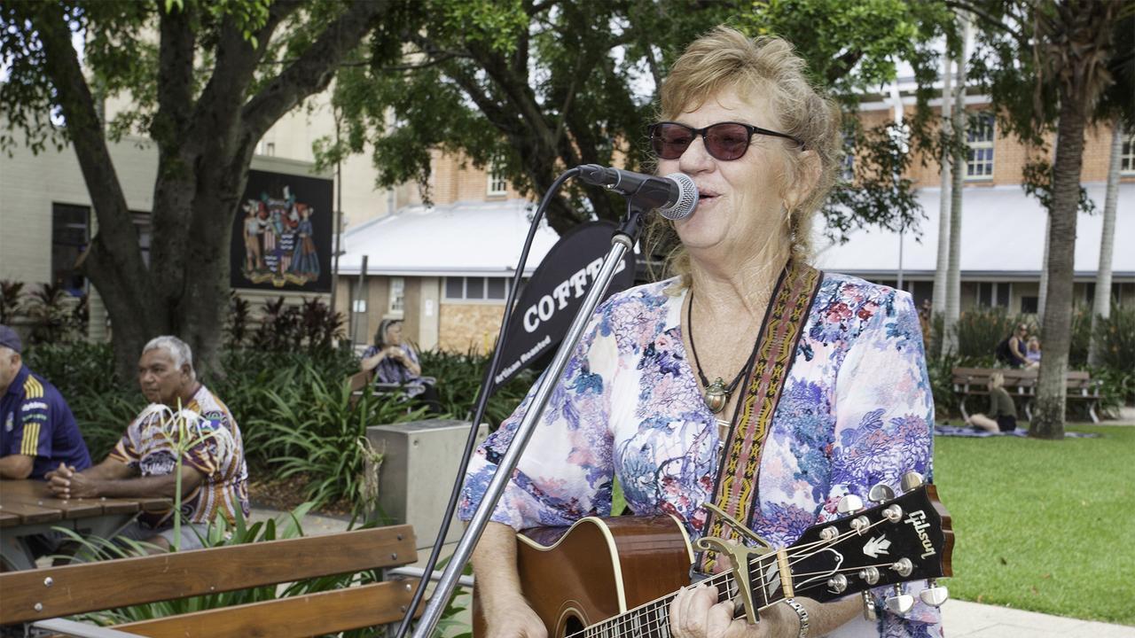 Musician Karen Thomsen entertains vistors at the Maryborough Markets.