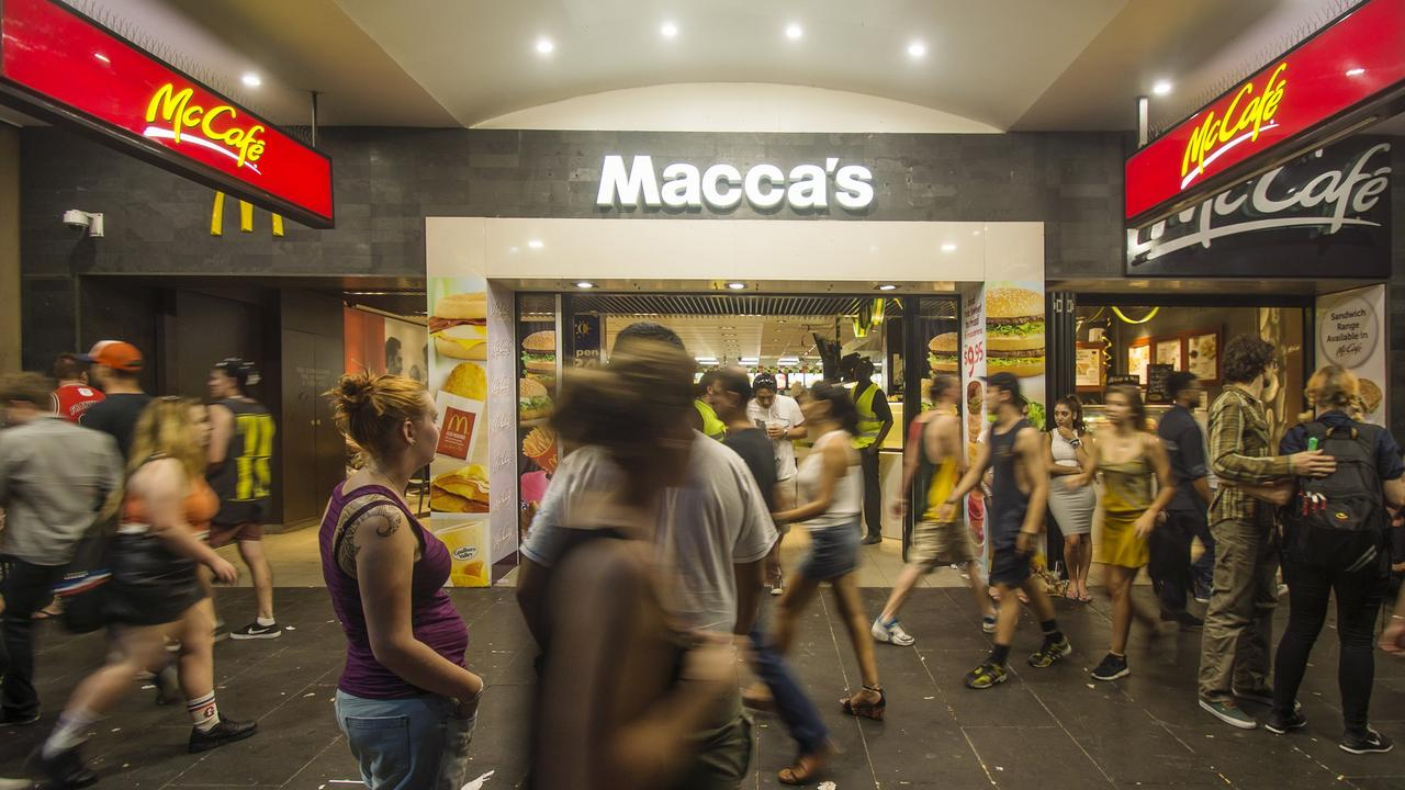 People walk past a McDonald's store, rebranded as Macca's, on Swanston St in Melbourne.