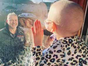 Heartbreaking pic of sick girl 'kissing' dad