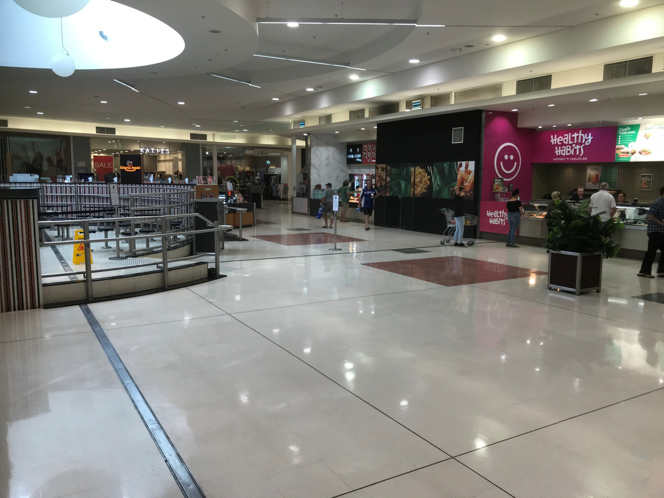 The food court at Grafton Shoppingworld is almost deserted during peak lunch time on Wednesday, 25th March, 2020, with all tables and chairs removed due to takeaway-only restrictions due to social distancing measures to prevent the spread of coronavirus.