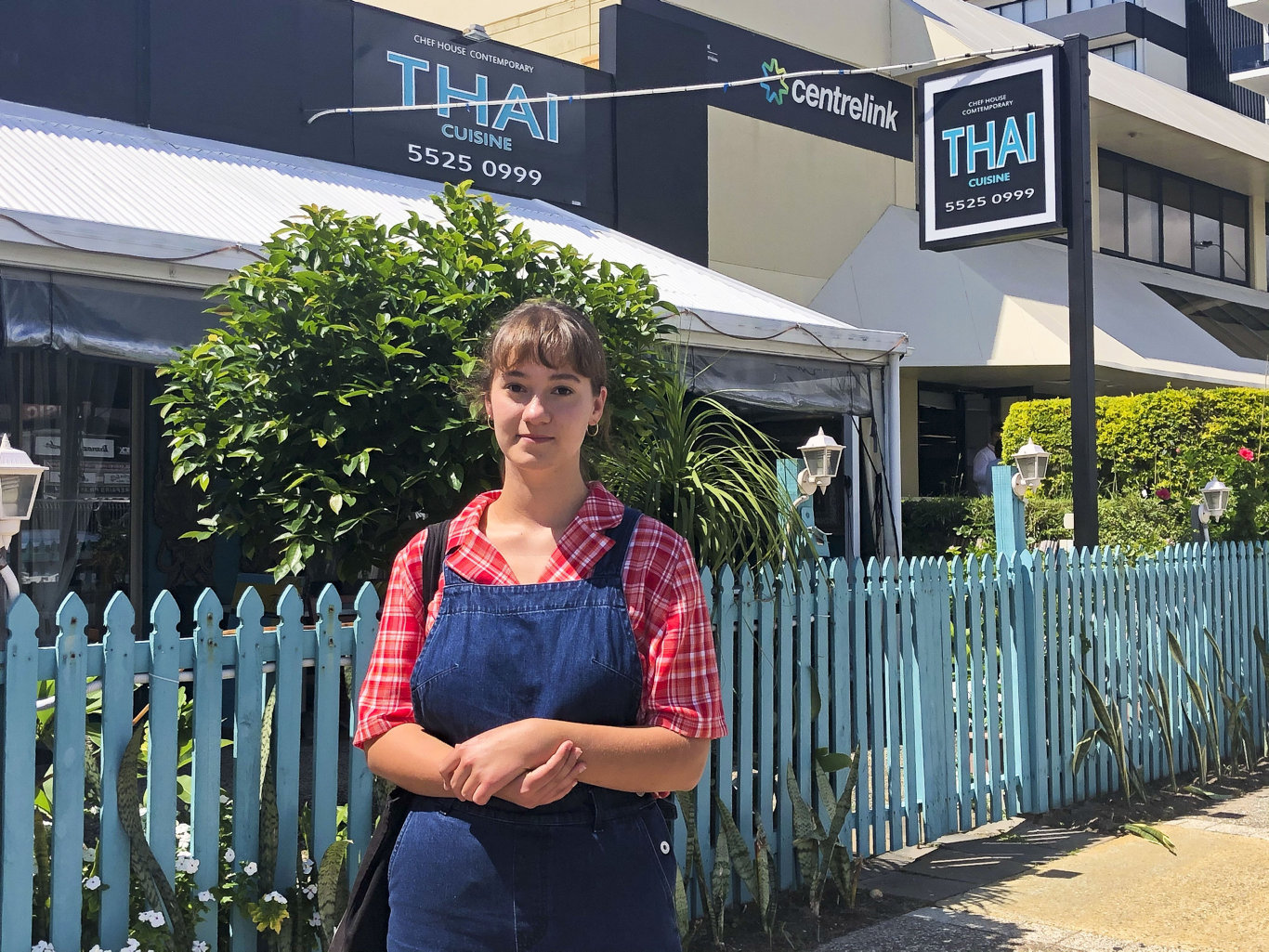 Tugun local Vivi Baker, 18, was one of the many hospitality staff laid off as a consequence of the government's coronavirus restrictions on restaurants. She is pictured here outside Currumbin Centrelink Photo: Jessica Lamb