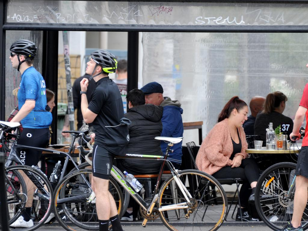 Customers were still ignoring social distancing while at cafes in Melbourne, but that will change under strict new measures. Picture: Andrew Henshaw