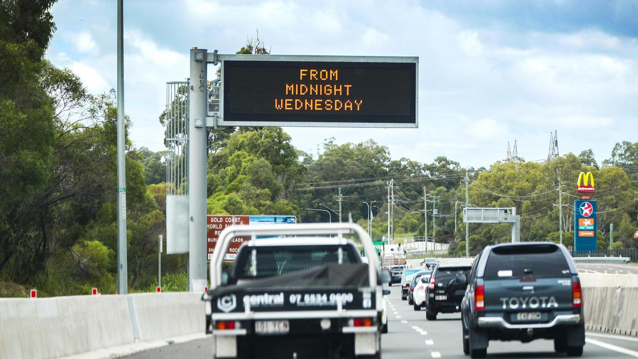 An electronic sign on the M1 south bound displaying the upcoming Queensland / New South Wales border closure. Picture: NIGEL HALLETT