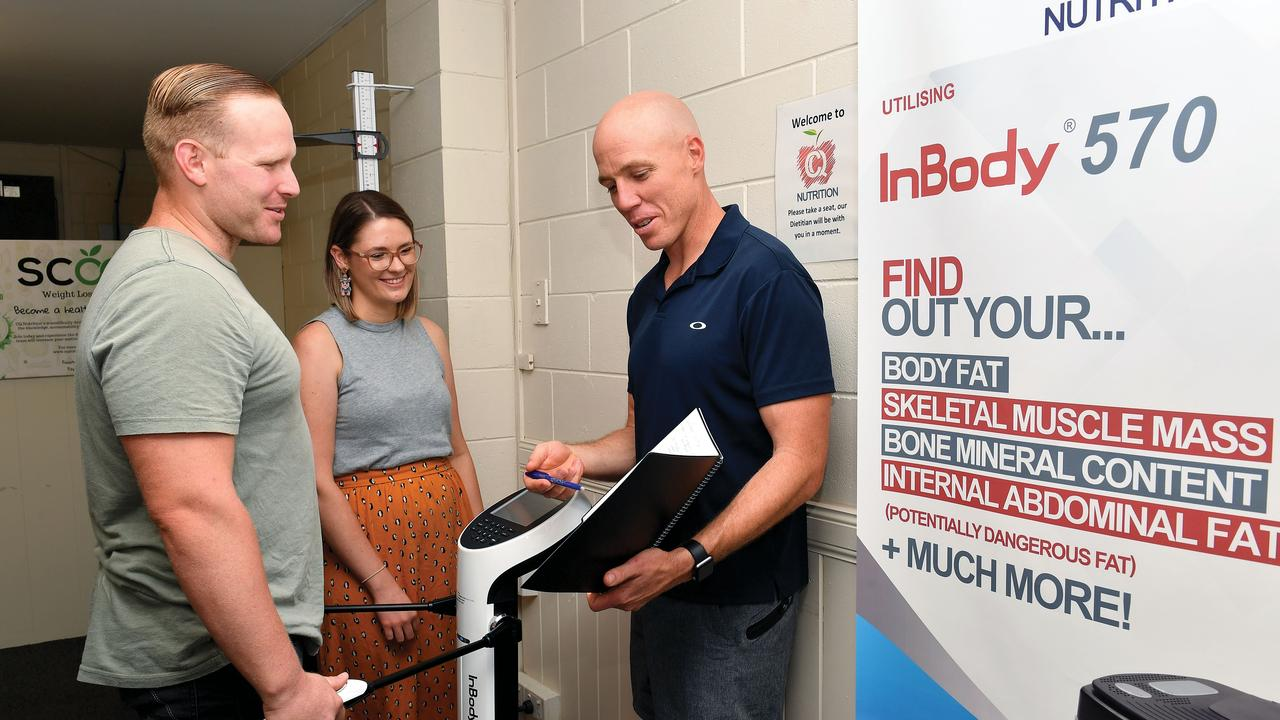 Luke Humphries-Opzeeland stands on the InBody Body Composition Analyser while dietitians Hayley Parker and Chris Hughes, from CQ Nutrition, watch on. Picture: Tony Martin