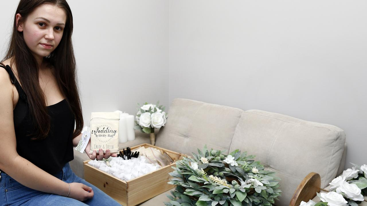 Chloe Williamson and the handmade decorations she made for her now cancelled wedding, in order to keep costs down. Picture: Tertius Pickard