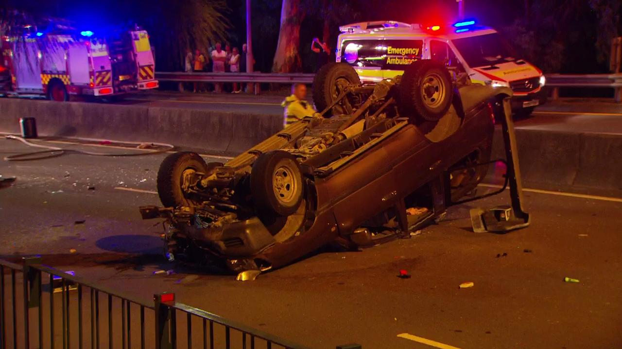The two women died after their Honda Sedan was hit by a Toyota LandCruiser and flipped onto its roof on Henry Lawson Dr in Peakhurst just before 8pm. Photo: Active Media Images