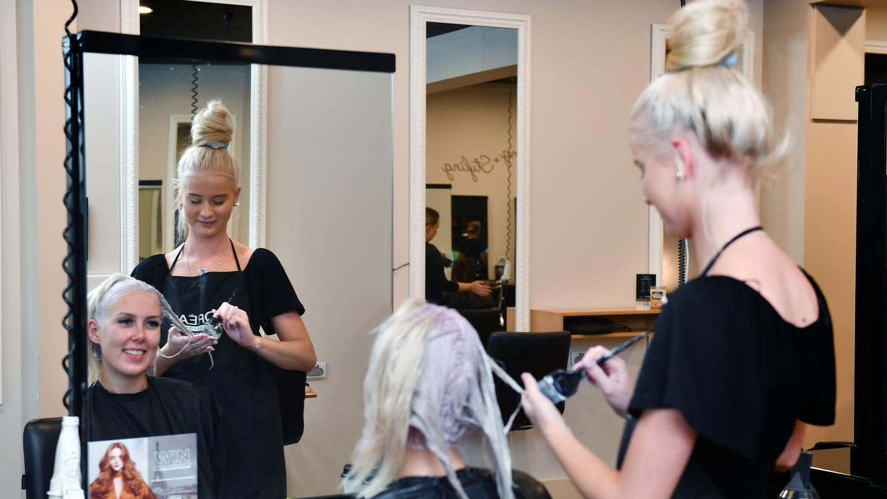 Hairdresser Emmersen McDonald from Gina T Hair & Beauty and client Mikhaile Stockdale. Picture: Tony Martin.