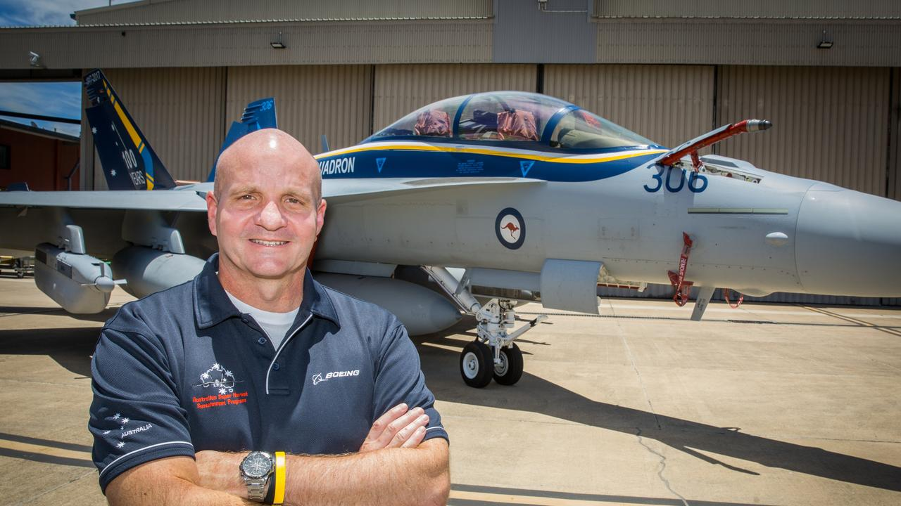 Air Combat Electronic Attack Sustainment Contract program manager Chris Gray in front of a EA-18G Growler.