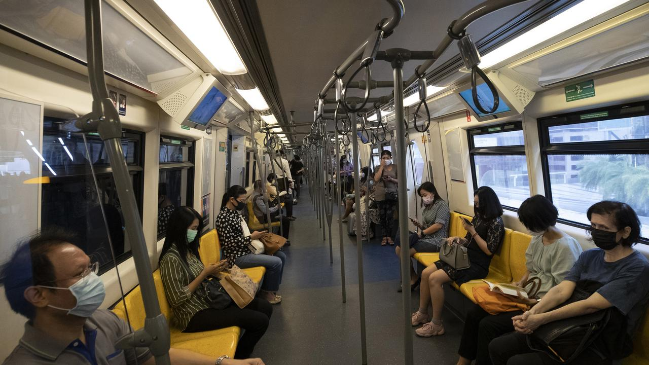 Commuters wear face masks to protect themselves. (AP Photo/Sakchai Lalit)