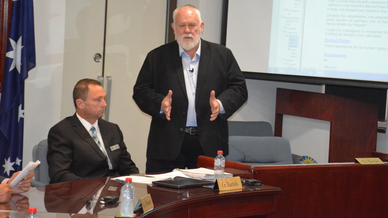 Deputy mayor Bill Trevor explains his reasoning, as Cr Jason Bartels listens.