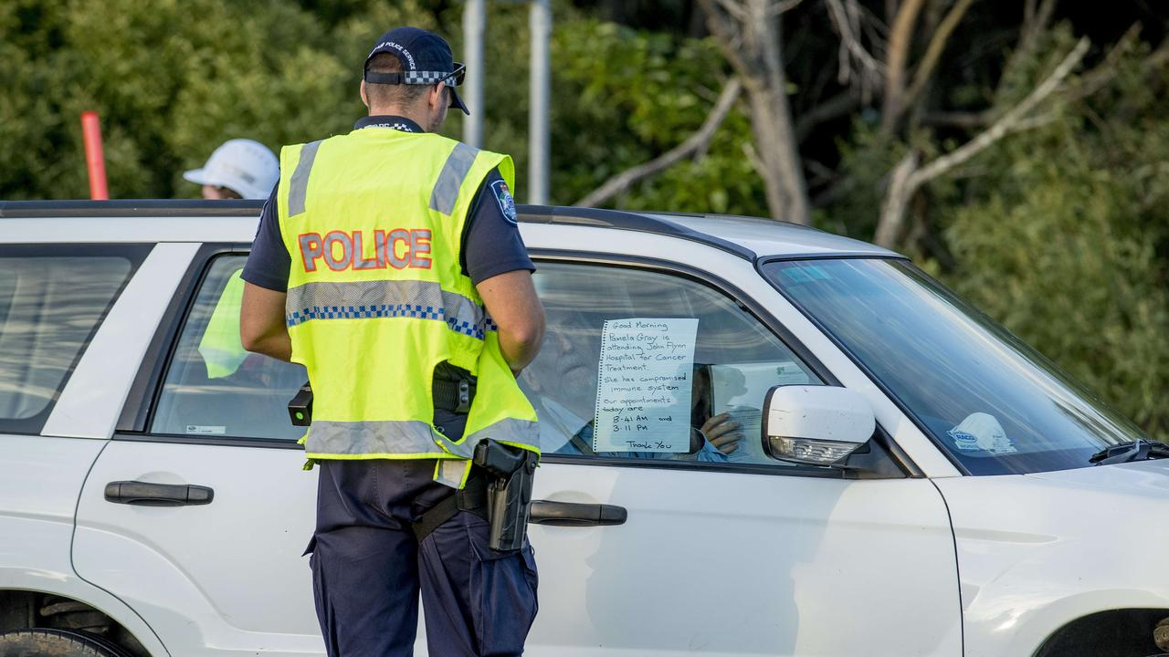 An older driver held a sign up to police regarding hospital treatment at John Flynn Hospital Picture: Jerad Williams
