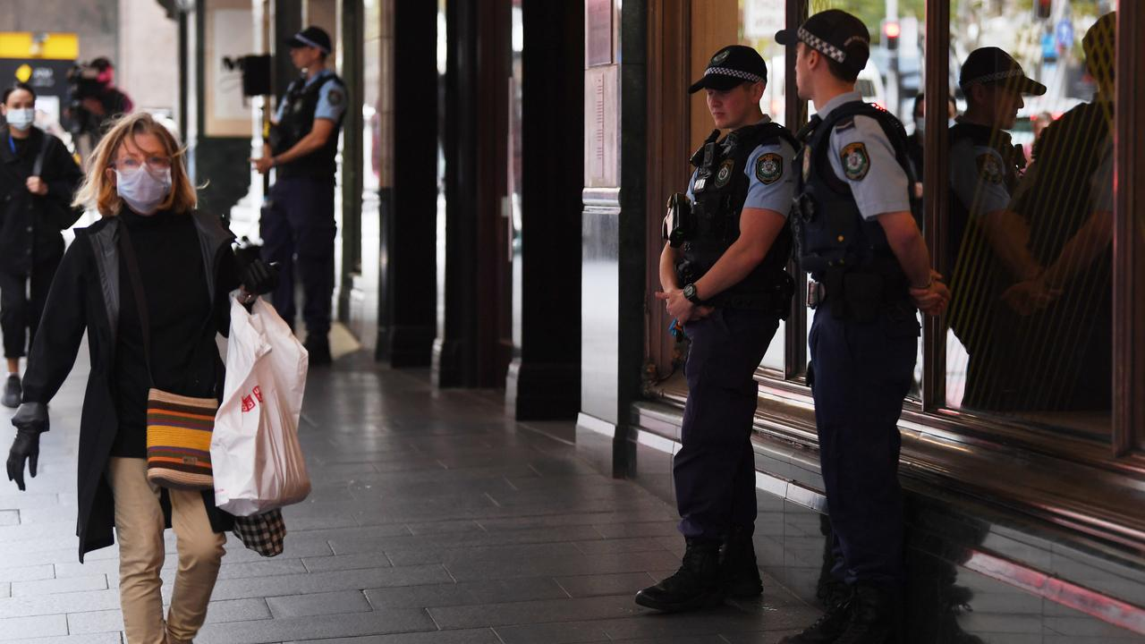 NSW Police stand guard outside the Swissotel Hotel in Market Street. Picture: Dean Lewins