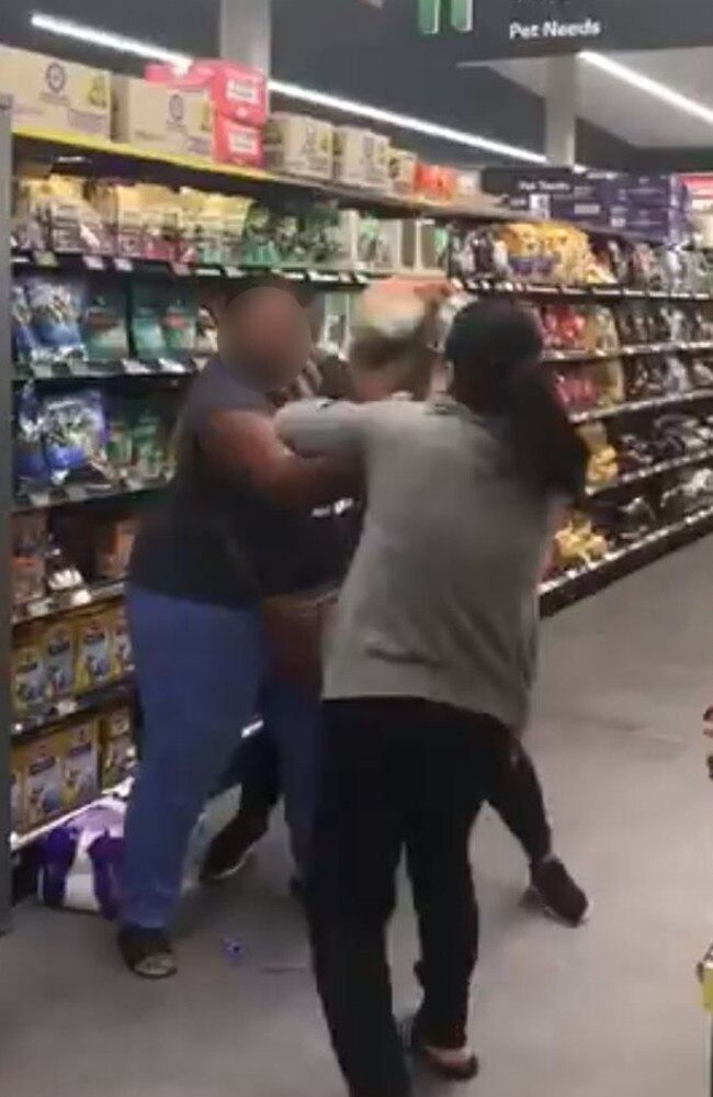 Shoppers fight over toilet rolls in Woolworths Chullora as the coronavirus craziness hits new levels. Picture: Twitter