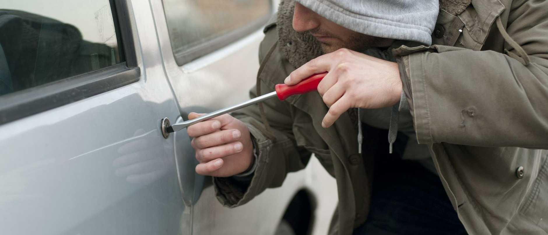 Thinkstock images of generic motor car break-ins crimes. Man wearing hood breaking into a motor car with a screwdriver.