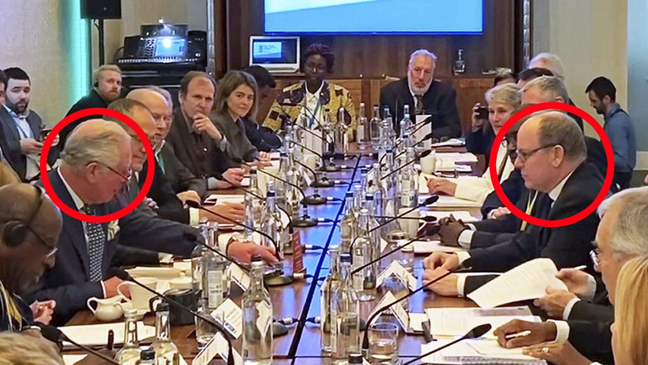 Image from video taken on March 10, 2020 of Britain's Prince Charles sat opposite Prince Albert of Monaco at the WaterAid charity's Water and Climate event in London. Clarence House office reported on Wednesday, March 25, 2020 that 71-year-old Prince Charles is showing mild symptoms of COVID-19 and is self-isolating at a royal estate in Scotland. It says his wife Camilla has tested negative. For