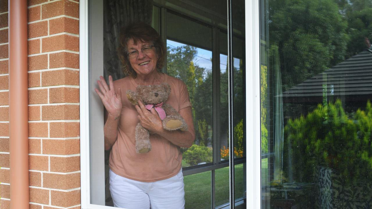 STAYING CONNECTED: Lyn Wright with her Teddy as they stay safe and isolated inside.