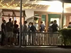 Large group gathers outside restaurant despite warning