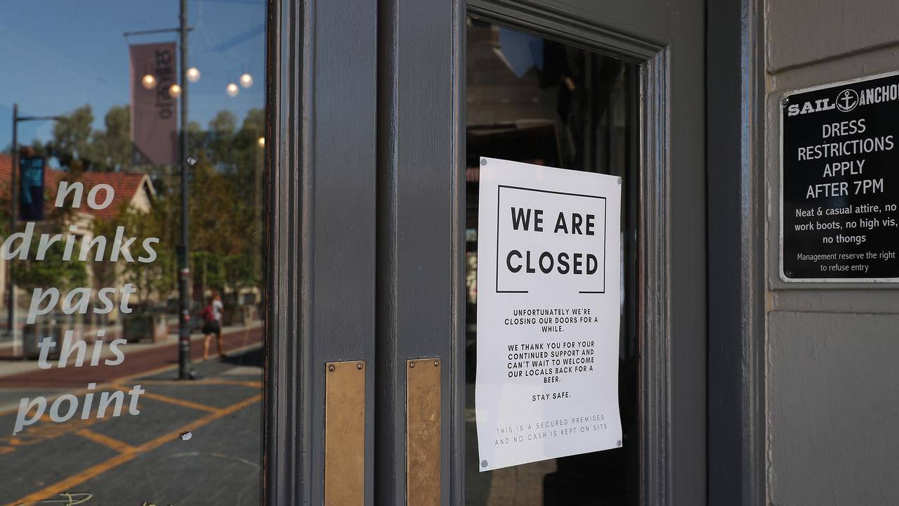 Signage advising a hotel is closed is seen on the windows of the Sail & Anchor on South Terrace on March 26, 2020 in Fremantle, Australia. Further restrictions on travel and movement have been put in to place as the federal government works to tackle the spread of COVID-19 across Australia. Picture: Paul Kane