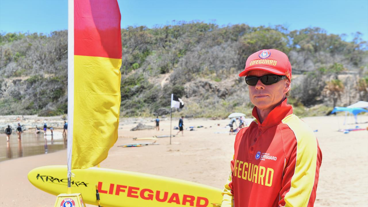 Lifeguard Ryan Miller at Agnes Water main beach in January this year. The flags will be up for the last time for the foreseeable future on Saturday.