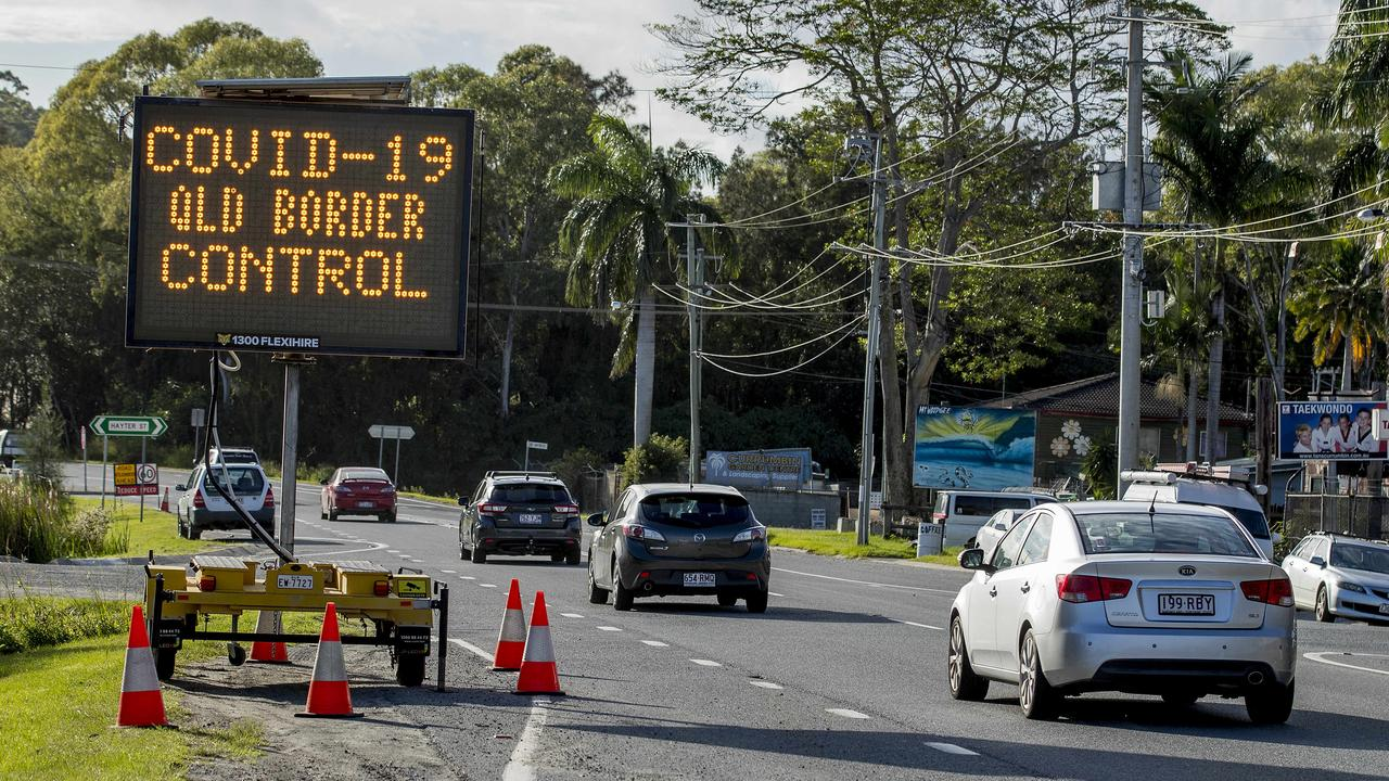 A road sign warning motorists of the COVID-19 QLD Border control. Picture: Jerad Williams