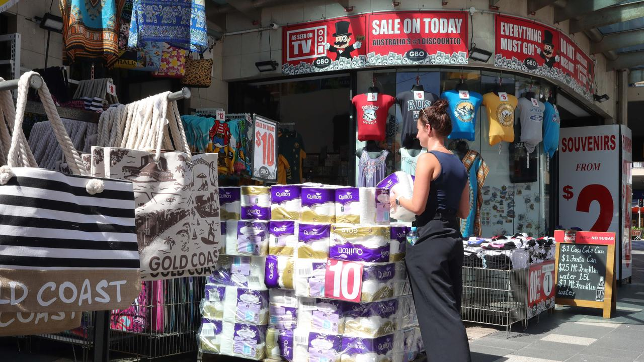 A customer purchases a packet of toilet paper at Global Brands Outlet in Surfers Paradise. Picture: Glenn Hampson.