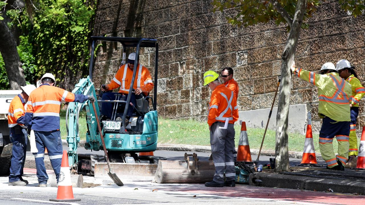Ausgrid workers digging a hole on Oxford St, Paddington to make repairs after recent storms. Picture: Jonathan Ng