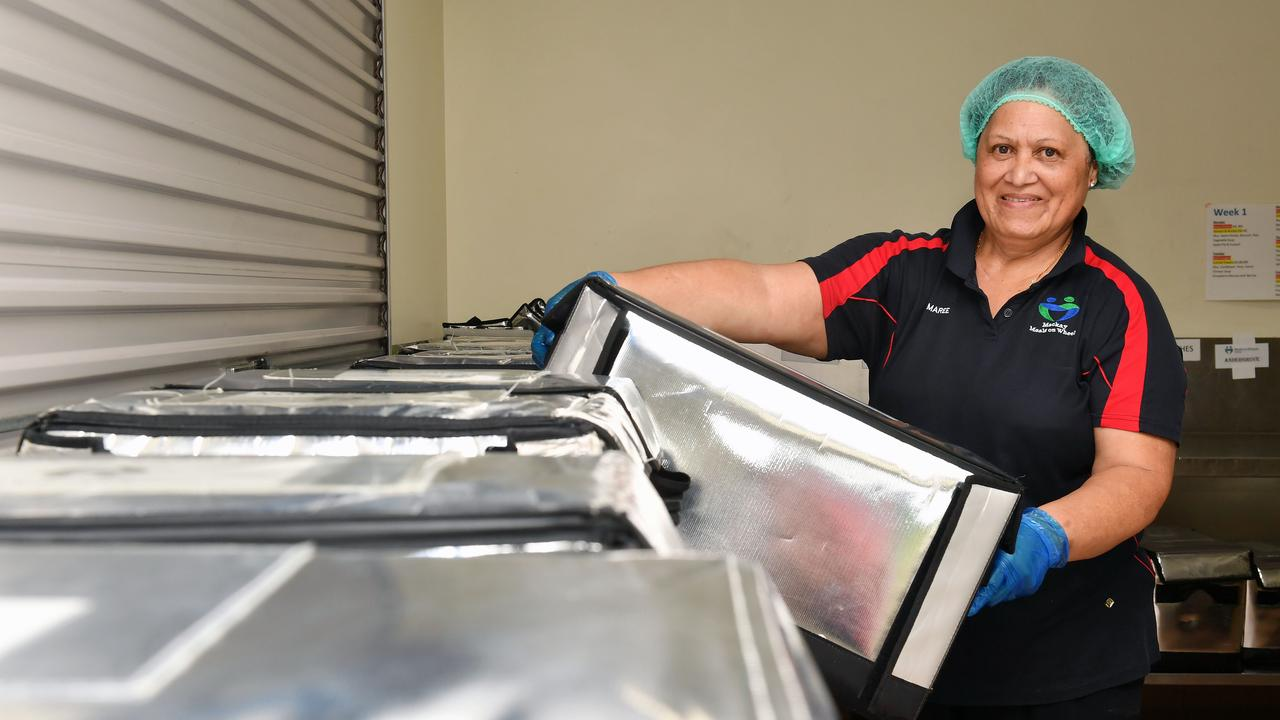 Mackay Meals on Wheels kitchen supervisor Marcelle Mauri gets the next meals ready to be delivered. Picture: Tony Martin