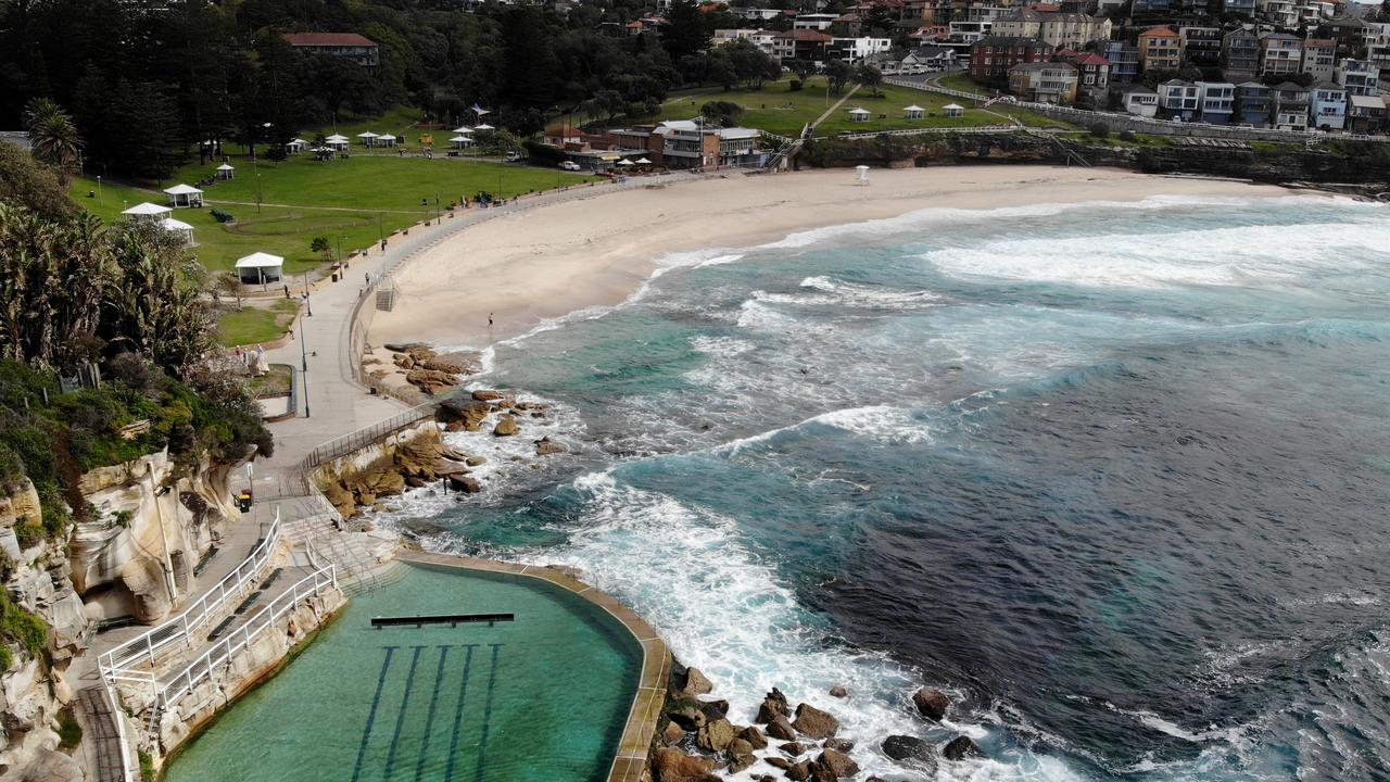 Bronte Beach is deserted, as can be seen from this drone image. Pictures: Toby Zerna
