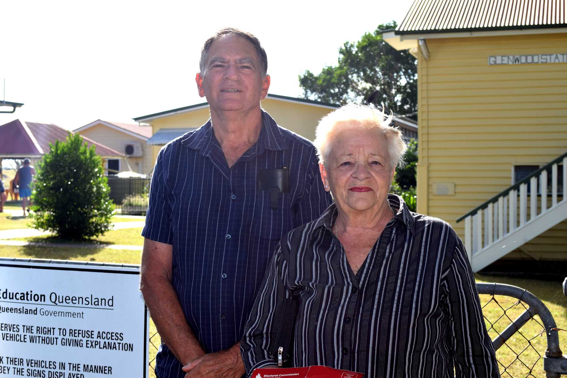 Colin and Dianne Day from Glenwood and voters socially distant while waiting to vote.