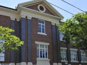 Parents frantic as school worker tests positive
