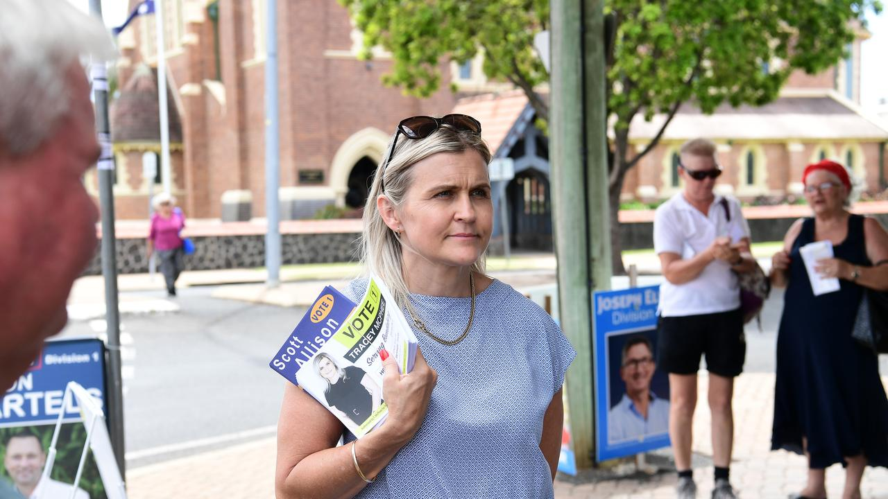 Tracey McPhee hand out how to vote card outside the early voting centre in Maryborough Street. This photograph was taken before candidates stopped handing out voting material due to coronavirus concerns.