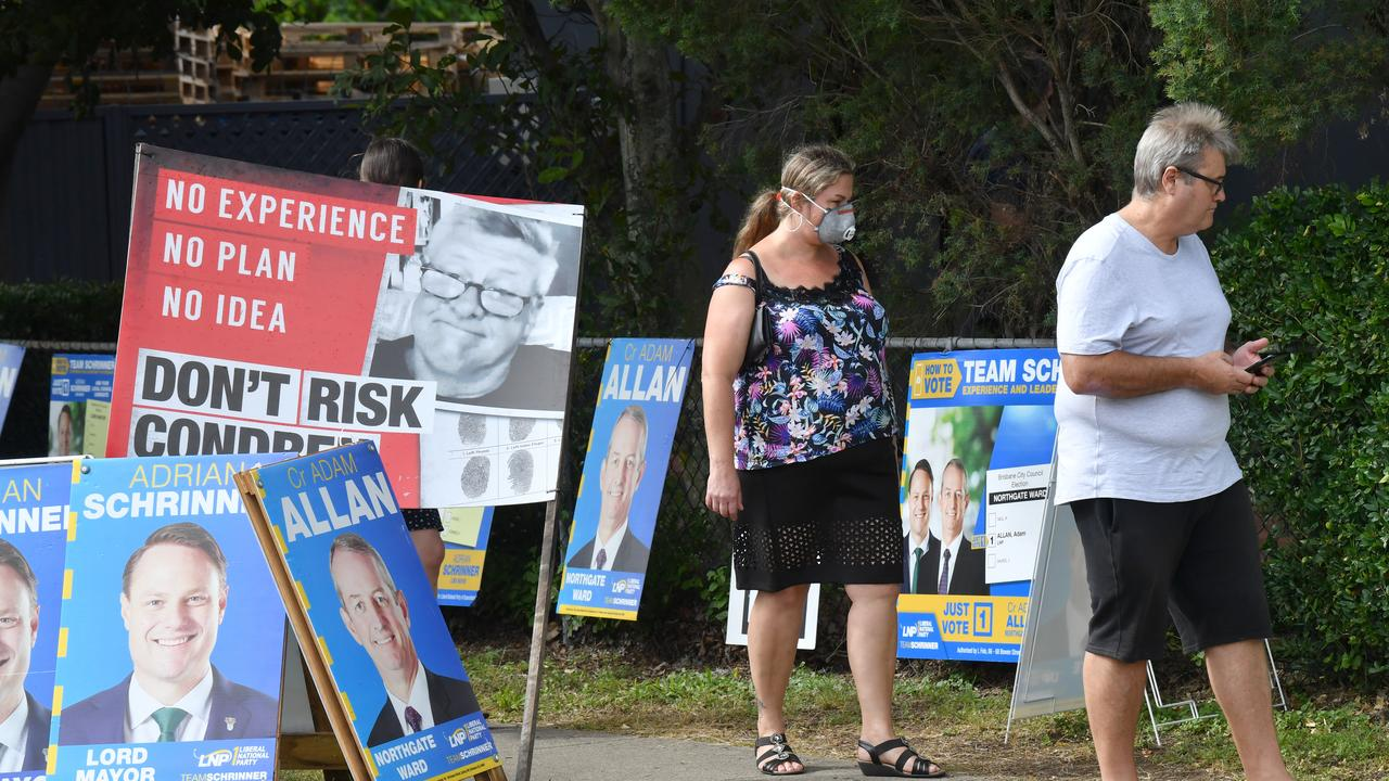 A voter in a mask is seen turning out to vote at a pre-polling booth in Virginia, on Brisbane's northside, on Friday. Picture: AAP Image/Darren England