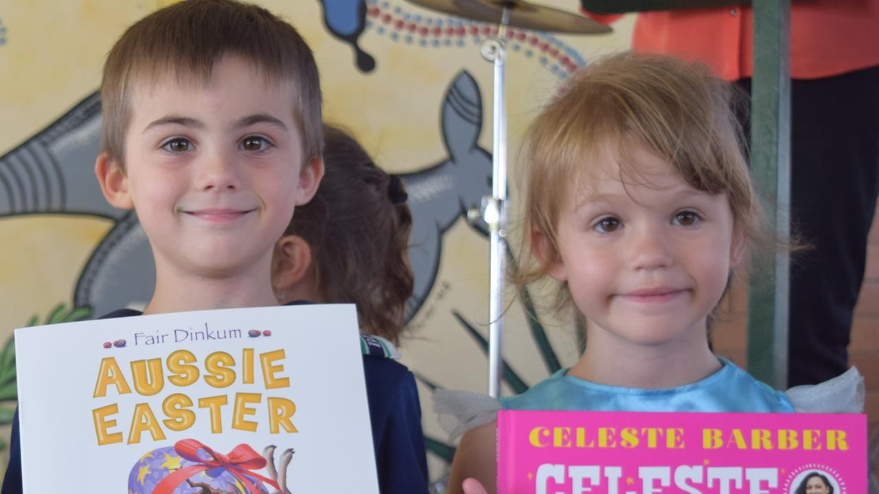 Dundula State School preppies Max Doueal and Lilly-May Carlton receiving their own book at the Books In Homes launch. Picture: Heidi Petith