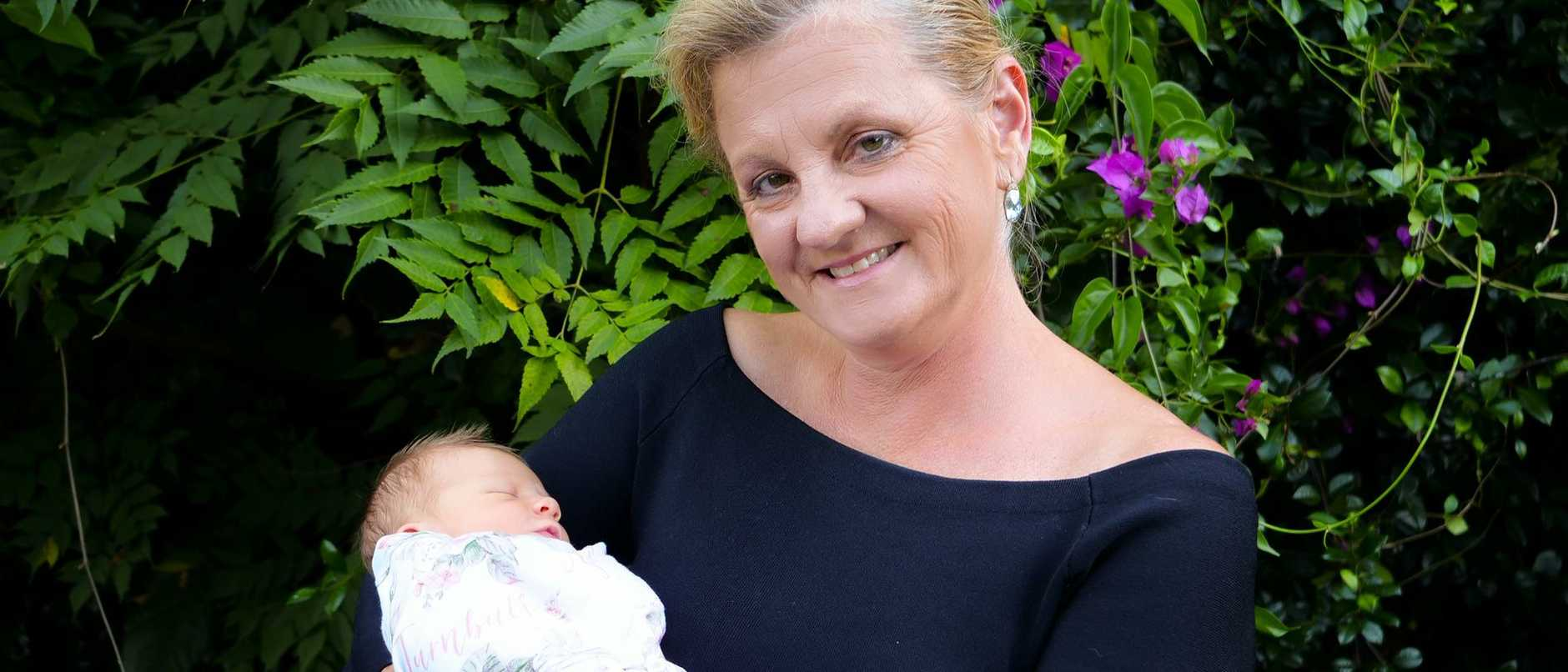 Redlands Mayor Karen Williams with new granddaughter Rose.