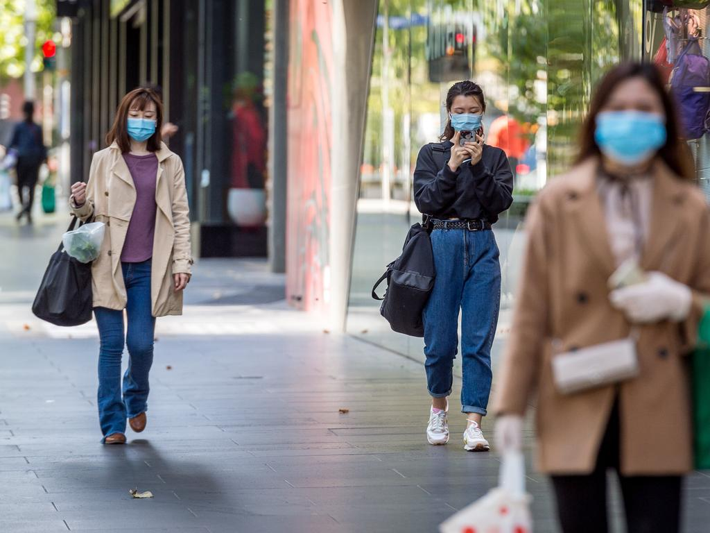Corona Virus. Melbourne CBD amid stage 2 restrictions. People wear masks during outings in the city. Picture: Jake Nowakowski