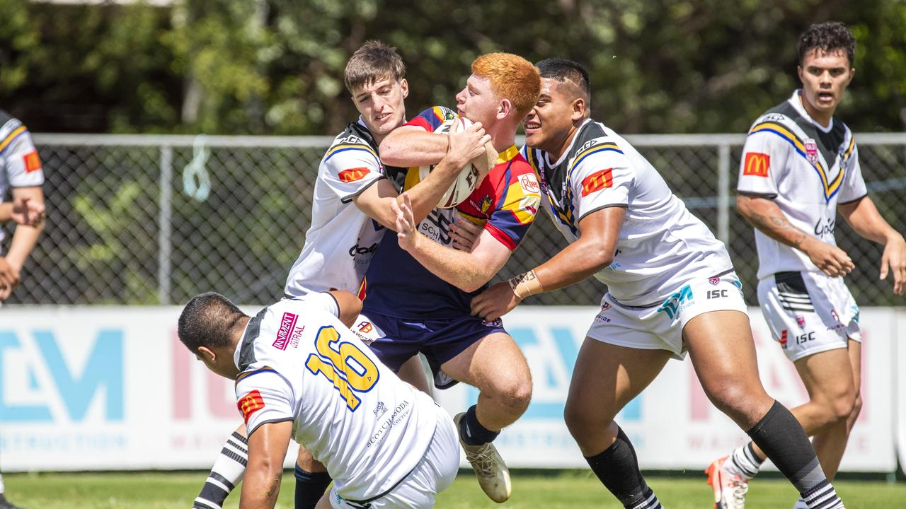 Sam Gillespie is tackled in the QRL Mal Meninga Cup game between Souths Logan Magpies and Western Mustangs. Photo: AAP Image/Renae Droop