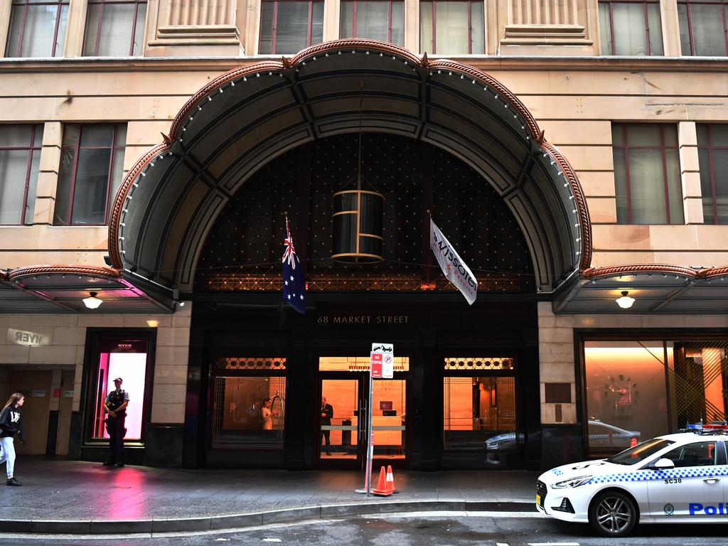 NSW Police stand guard outside the Swissotel Hotel in Market Street, Sydney. Picture: Dean Lewins/AAP