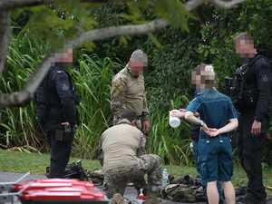 Siege drama: Cops thought gunman taken by croc
