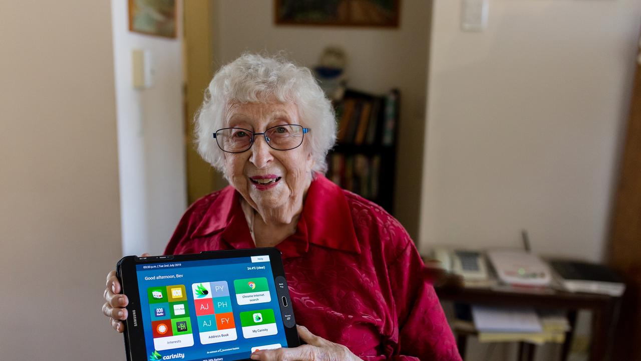 Carinity Home Care client Beverley Young with her Mobi tablet designed to allow seniors to stay connected. Photo: Contributed.