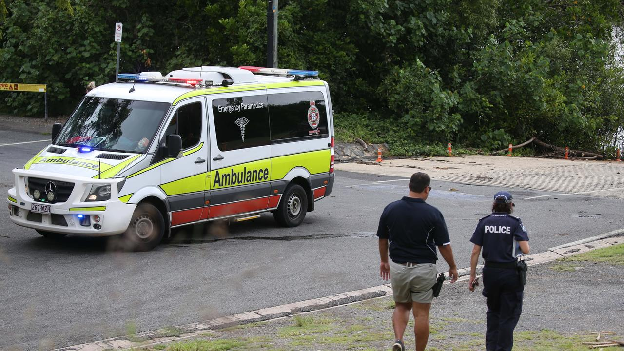 Queensland Ambulance Service and police at the scene. Picture: Stewart McLean