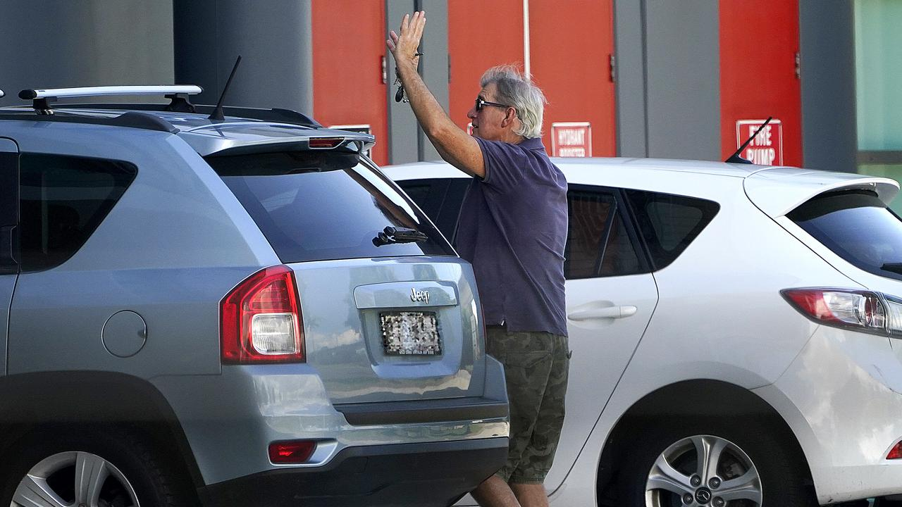 A man waves to a family member at the Airport Novotel Hotel in Brisbane after passengers were taken from a flight from Bali to the hotel for quarantine in Brisbane, Sunday, March 29, 2020. Overseas arrivals are now forced to be quarantined in hotels in a bid to stop the spread of COVID-19 (AAP Image/Dave Hunt) NO ARCHIVING