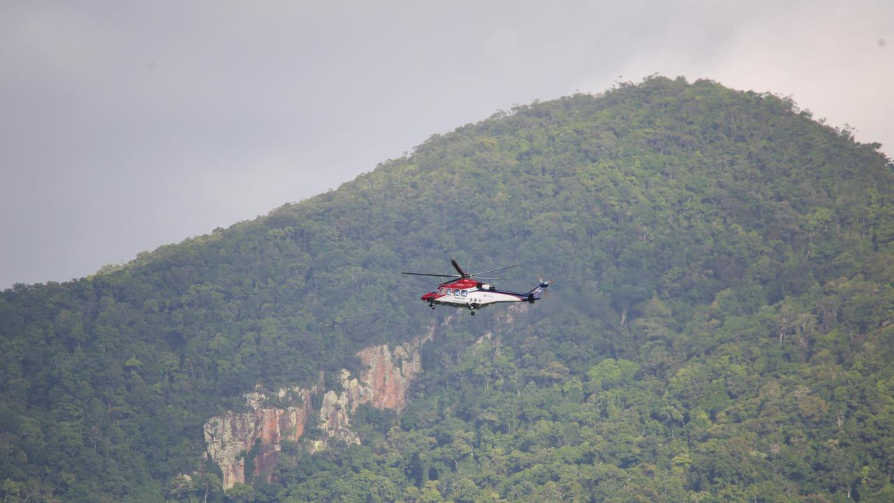 The Rescue 510 rescue helicopter assisting police on the Captain Cook Highway. Picture: PETER CARRUTHERS
